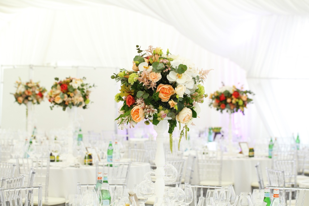 Serving on the table restaurant catering elegant floral arrangement wedding tent White canopy